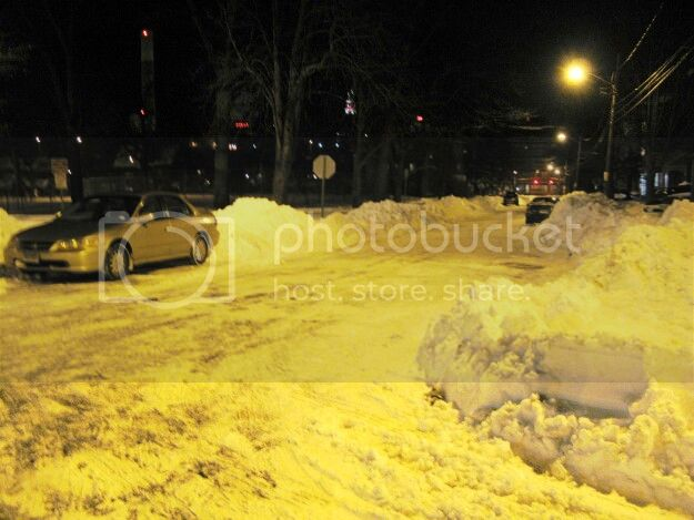 Vehicles freshly parked on Putnam Street during the parking ban on Sunday evening.